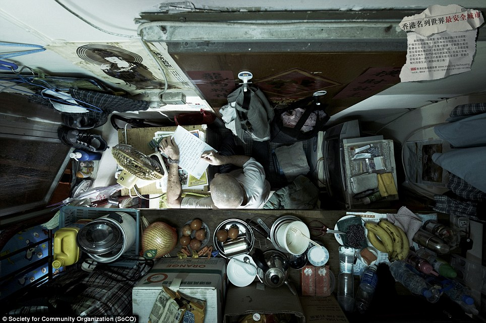 Society for Community Organisation's images of cubicle apartments in Honk Kong's slums are unbelievable, literally