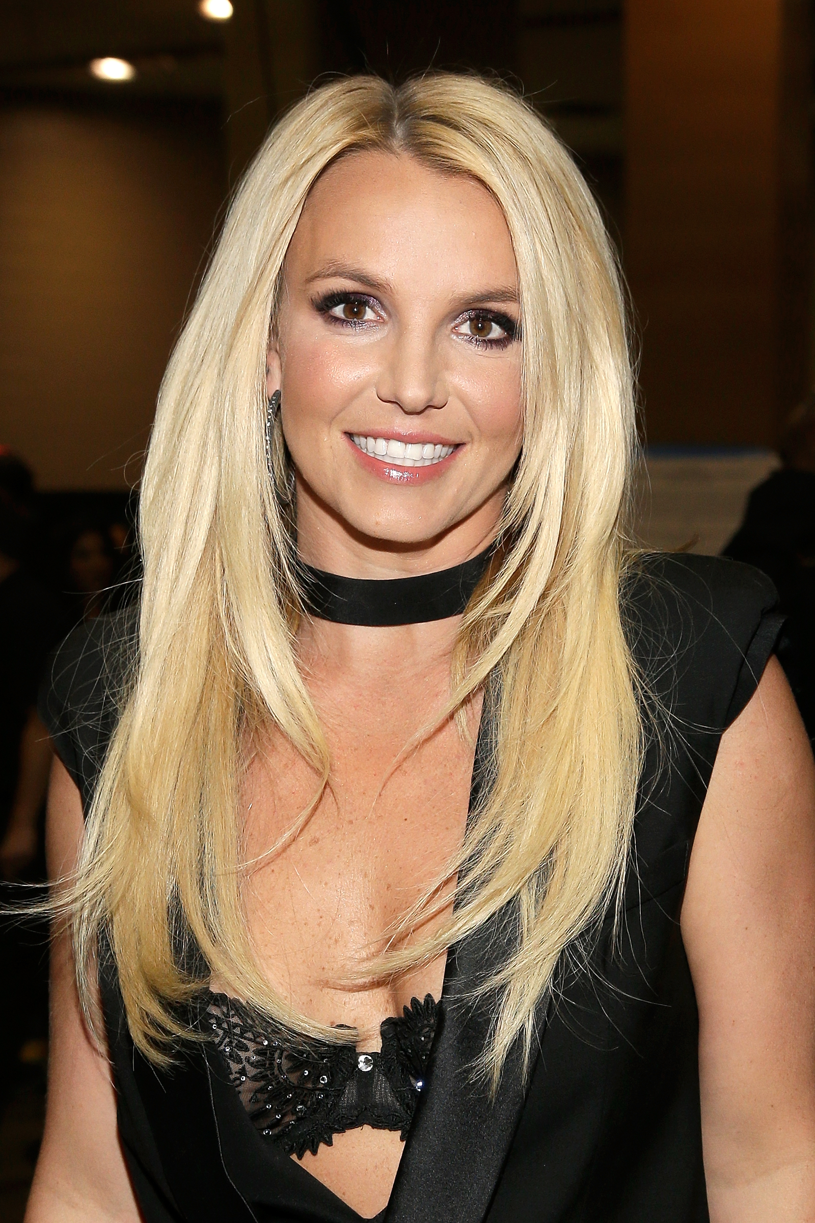 Watch Britney Spears dance around in a tiny bikini, reach new levels of sexiness