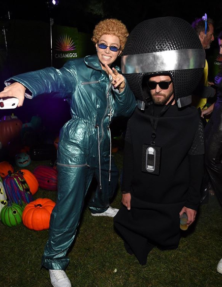 Jessica Biel attended the Casamigos Halloween Party as N'SYNC-era Justin Timberlake, while he went as her microphone.